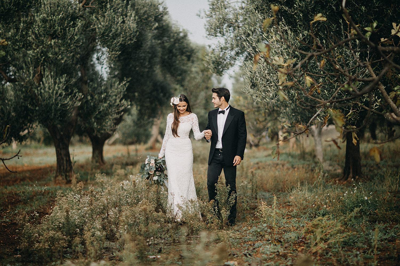 bride and groom walk in olive garden