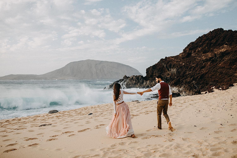 Bride groom walking beach La Graciosa Canary Island
