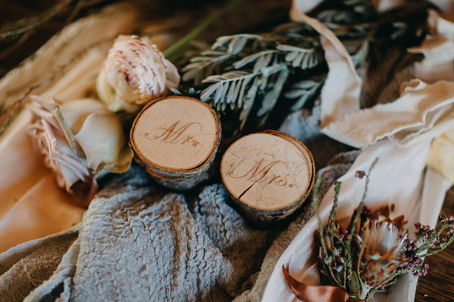 detail wooden wedding ring boxes on table