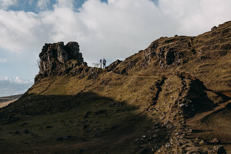 bride and groom on top mountain Isle of Skye