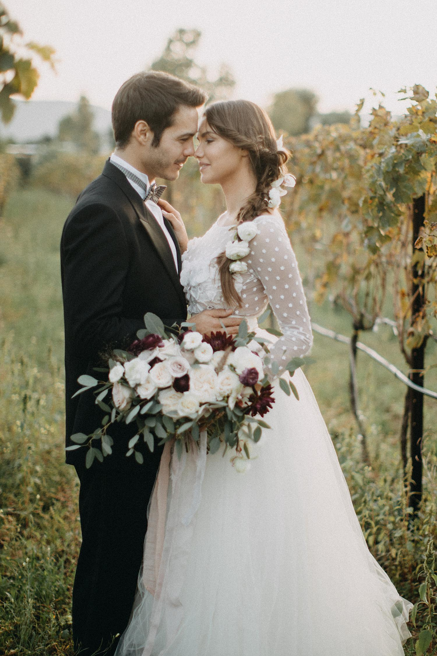 Bride and groom in grape plantation