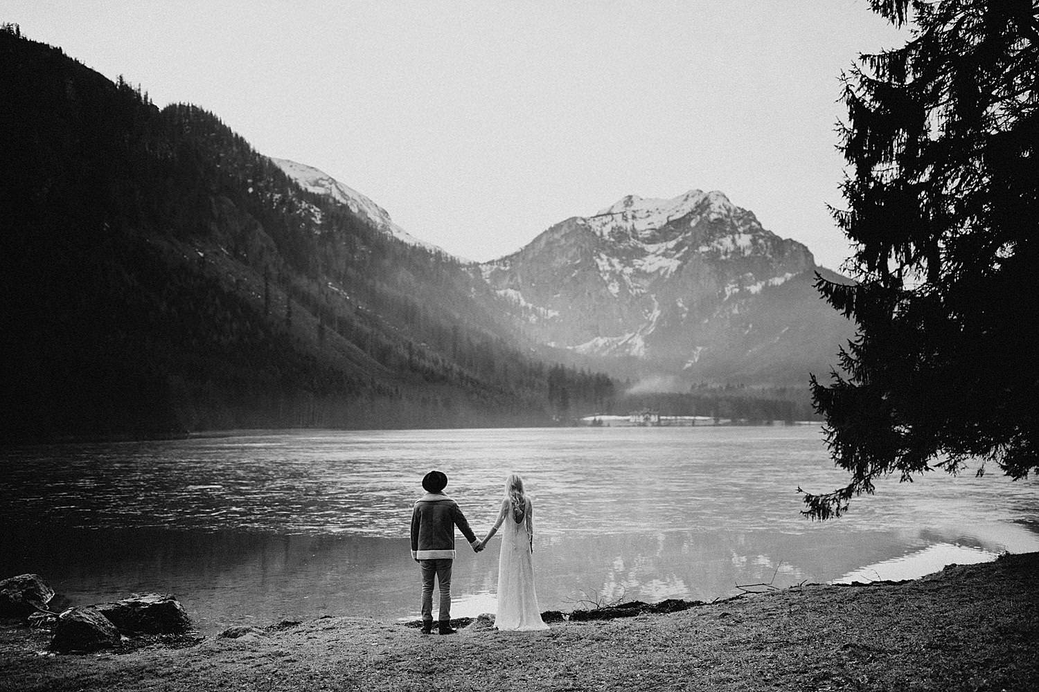 Bride groom looking over Langbathsee lake Austria wedding