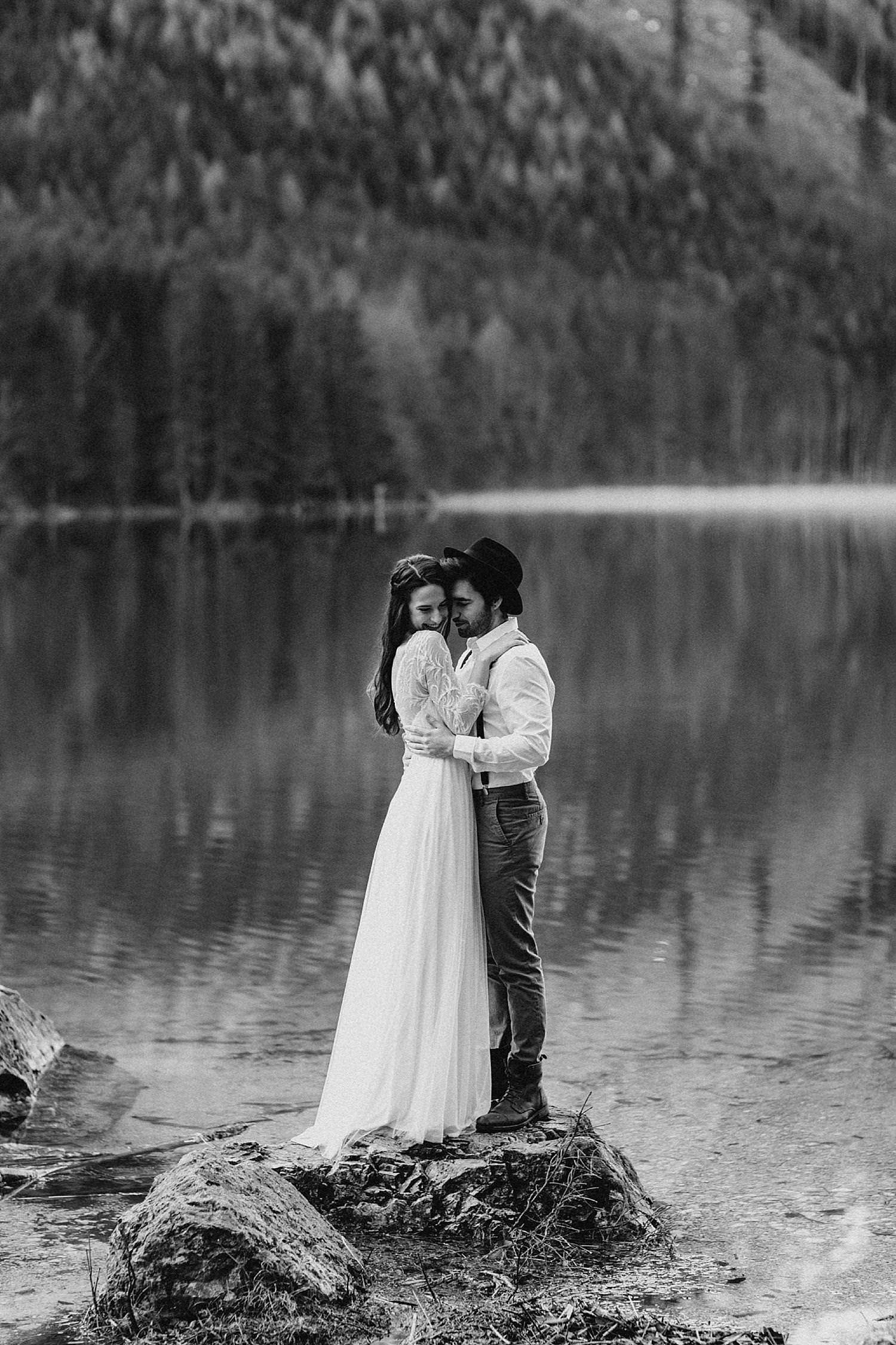 Wedding couple hug on rock Austria