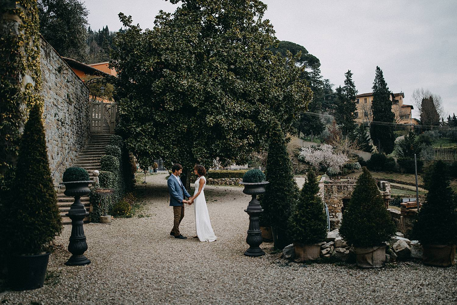 Toscany Villa wedding couple hand in hand